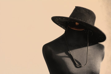 Mannequin is wearing a cowboy hat 98c1b4baccd8