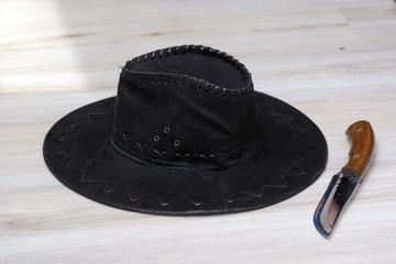 cowboy hat and hunting knife on a light background 6e702af9c766