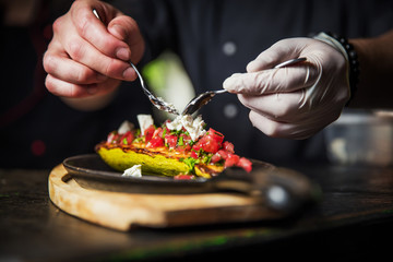 chef hands decorate dish