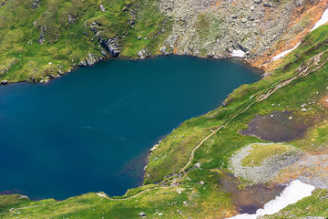 summer time in romanian carpathians. beautiful scenery of fagaras mountains. lake capra view from above