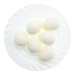 Peeled boiled eggs in a plate on a white background