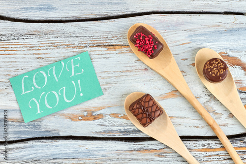 Romantic Background With Chocolate Candies Wooden Spoons With