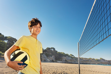Portrait of teenage volleyball player on the beach