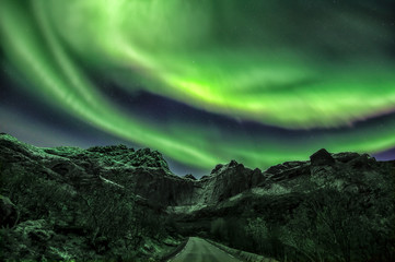 Northern lights above Mt. Stjerntindene in Flakstad municipal, Lofoten