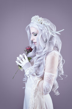 Young princess holding a rose in her hands