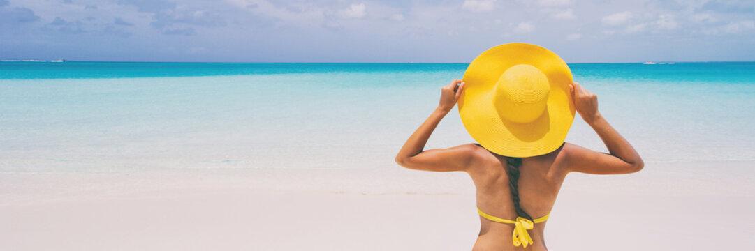 Luxury beach travel - Sexy woman sunbathing on the beach with bikini beach body. Beautiful multiracial Asian Caucasian female model on travel vacation holidays. SLOW MOTION.