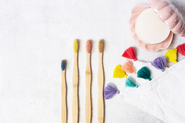 A family set of wooden bamboo toothbrushes on white background