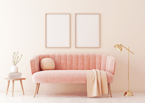Poster mock up with two vertical frames on beige wall in living room interior with pastel coral pink sofa, lamp and plant in vase. 3D rendering.