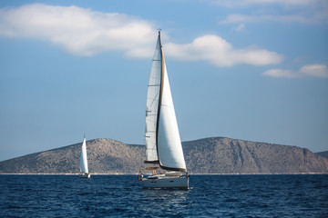 Wall Mural - Sailing luxury yacht boats on the Aegean Sea in Greece.