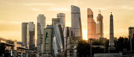 Fototapete - Panorama of Moscow with skyscrapers of Moscow-City at sunset, Russia