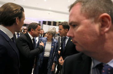 Britain's Prime Minister Theresa May and Dutch Prime Minister Mark Rutte arrive for the family photo of Arab and European leaders during the first EU-Arab League Summit in Sharm El Sheikh