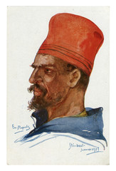 French historical postcard: portrait of a soldier of the colonial troops in a high red cap with a beard and a mustache. world war one 1914-1918. Republic of france