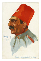 French historical postcard: portrait of Turkish infantry soldier. A man with a mustache in a high red FEZ with a Crescent moon on it. world war one 1914-1918.  Ottoman empire