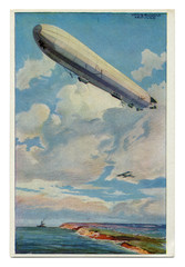 Old German postcard: A huge Zeppelin airship flies over the coast of the sea against the background of a warship and aircraft, first world war 1914-1918