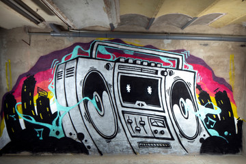 ghettoblaster graffiti on a wall