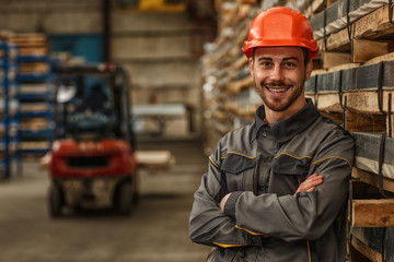 Shot of a bearded handsome metalworker in protective uniform and hardhat smiling joyfully to the camera posing at the warehouse. Engineering, construction supplies, logistics concept