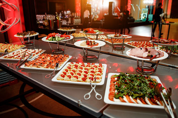Banquet in the restaurant. Various delicacies, snacks at the gala event.