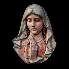 Antique statue of Virgin Mary against black background.