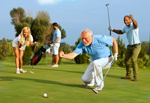 Senior golfer putting