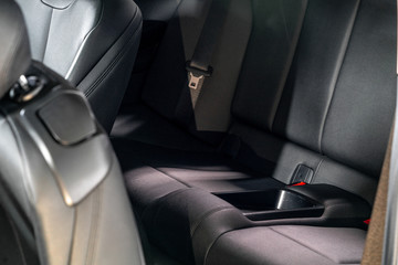 Dark luxury new car Interior. Back passenger seats in modern car, side view.