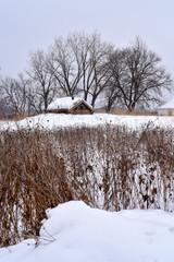 historic farm building in winter field