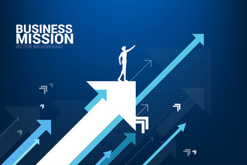 Silhouette of businessman point forward on moving up arrow. concept of growth business and leadership. Wall mural