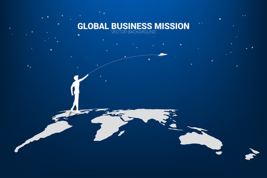 silhouette of businessman throw origami airplane on world map. Concept of world business market vision mission start up