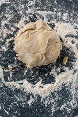 Dough ball on floured marble in kitchen