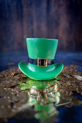 Saint Patrick's Day green leprechaun hat on gold shamrocks