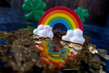 Saint Patrick's Day gold shamrocks reflecting colorful rainbow