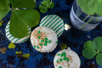 Saint Patrick's Day green clover with festive cookies with green decorations