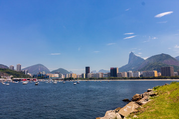 Panoramic morning view of the beach and Botafogo cove with its buildings, boats and two brothes, gavea and corcovado mountains in Rio de Janeiro