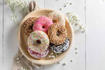 Tasty and homemade donuts with various decoration