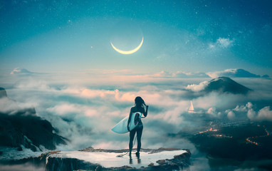Surfer slender girl watching dream standing in clouds with beautiful landscape and moonlight on background