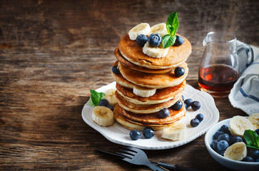 Pancakes with berries and honey, copy space