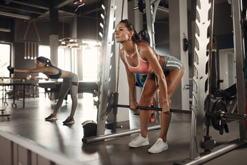 Fitness workout. Women exercising at gym together