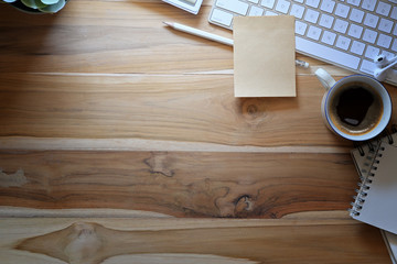 Wooden workspace with office supplies and copy space