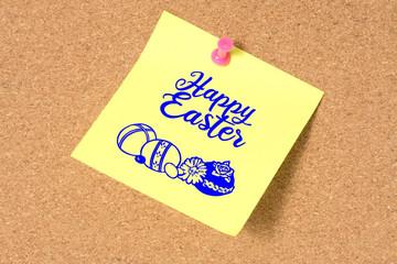 Eine Pinnwand mit einer Notiz Frohe Ostern