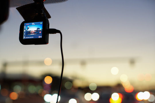 Windshield mounted dashcam recording while driving