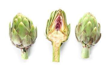 Raw artichokes on white background Wall mural