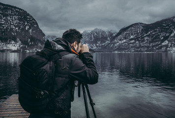Travel blogger taking picture of mountain landscape