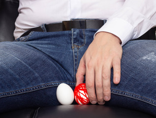 A man holds on to an egg in the scrotum. He has varicose veins of the spermatic cord, varicocele, problem, vein plexus