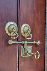 Door - an old big key in a gold door lock