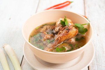 Chicken soup in bowl.