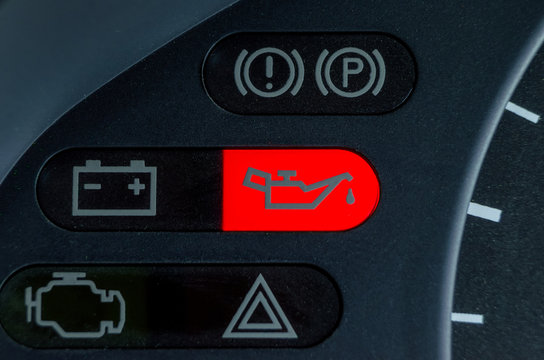 Screen symbols battery and Oil lamp warning light in-car dashboard