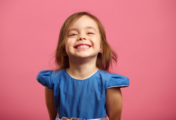 Female portrait of charming child of three years with a beautiful smile.