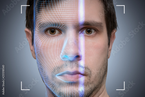 Biometric scanner is scanning face of young man  Artificial