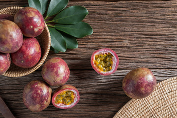 Half of  passion fruit and organic passionfruit on wood basket, wooden background. Top view and Copy space.