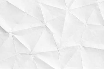 Texture of old crumpled origami paper, white background in modern style. 3D shapes of curved lines for patterns and wallpapers.