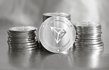 Tronix (TRX) digital crypto currency. Stack of silver coins. Cyber money.